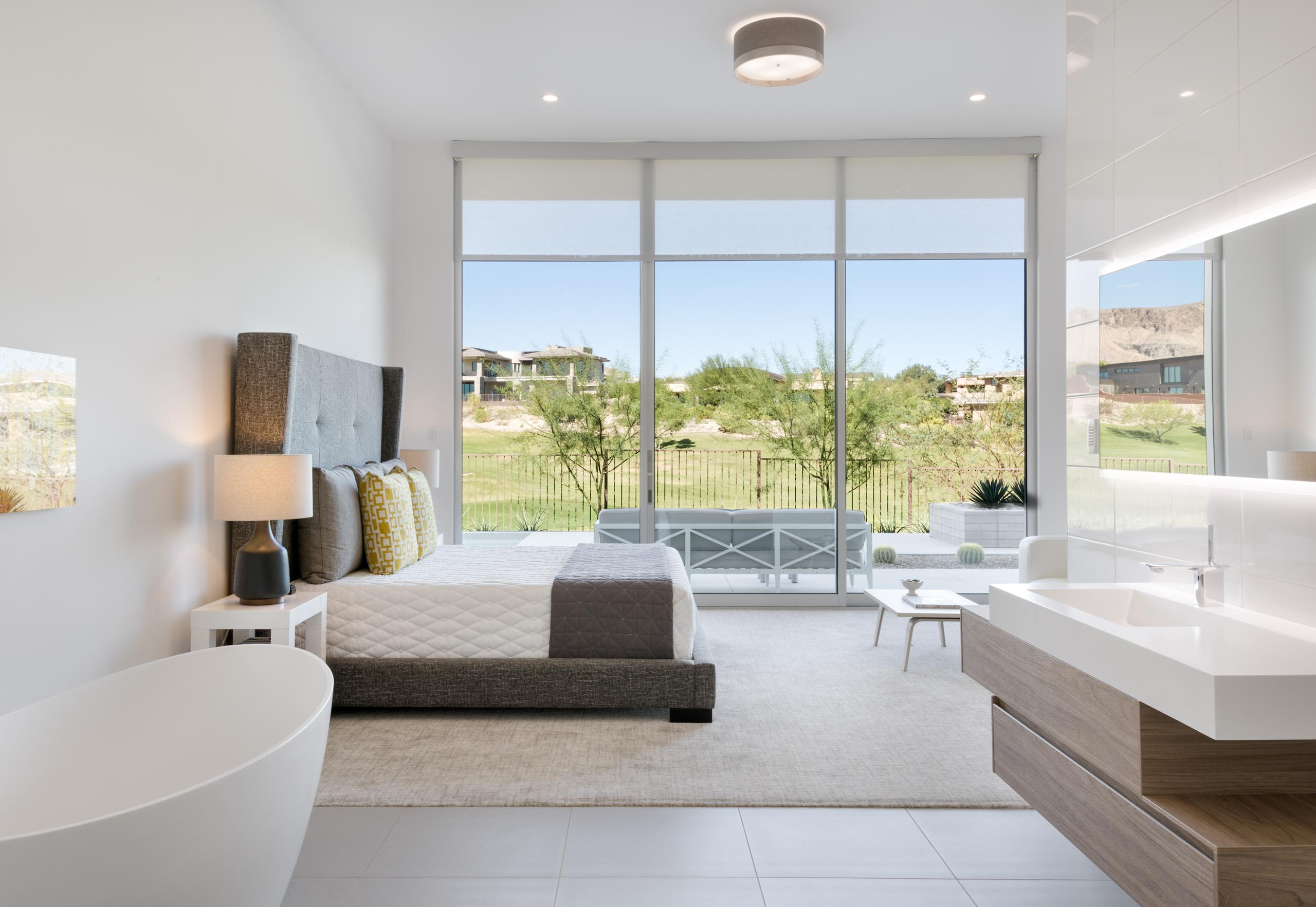 Shades of White's large moving walls of glass flood interior spaces with natural light.