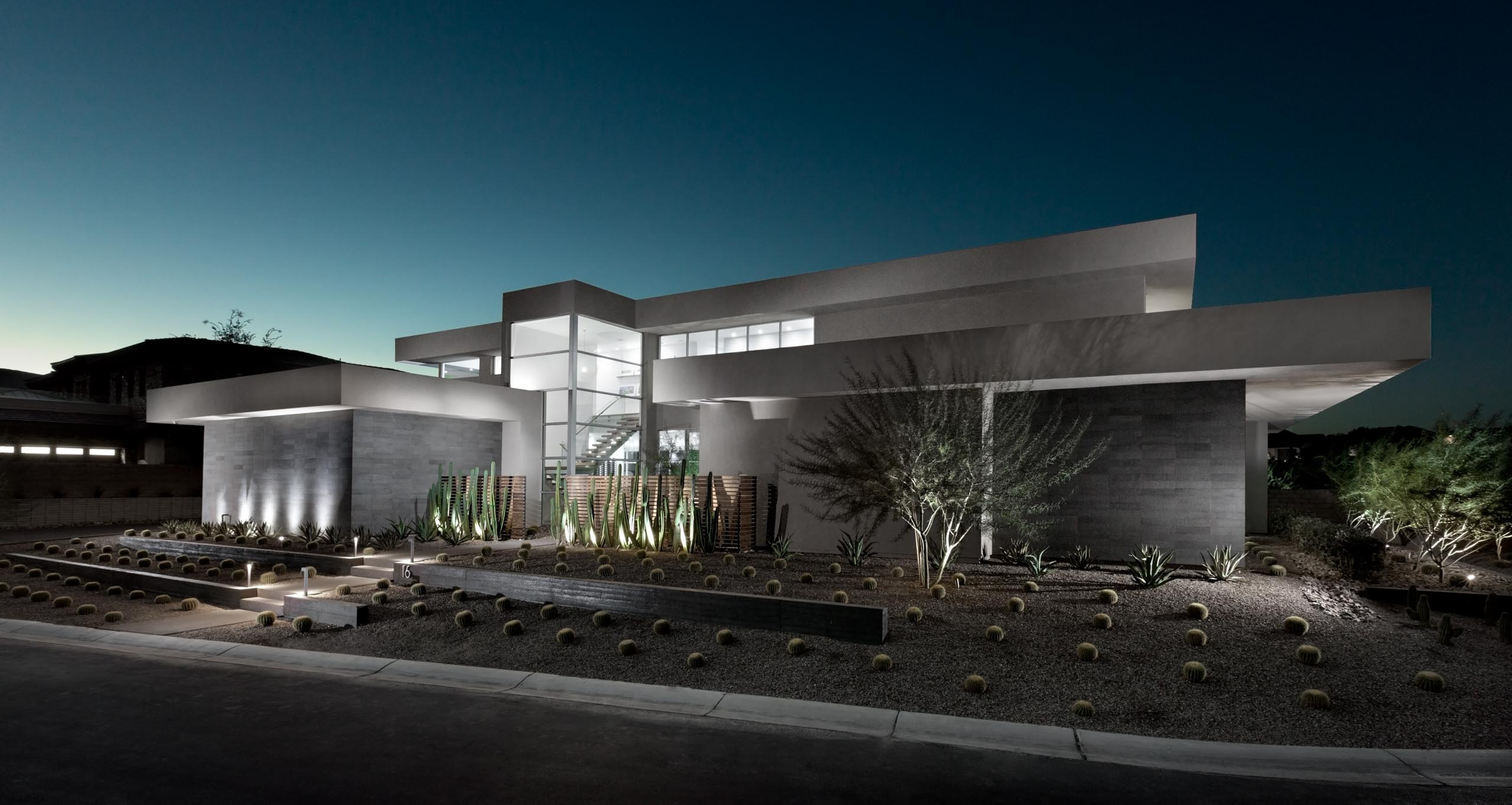 The home's design has a strong connection to the natural desert landscape.