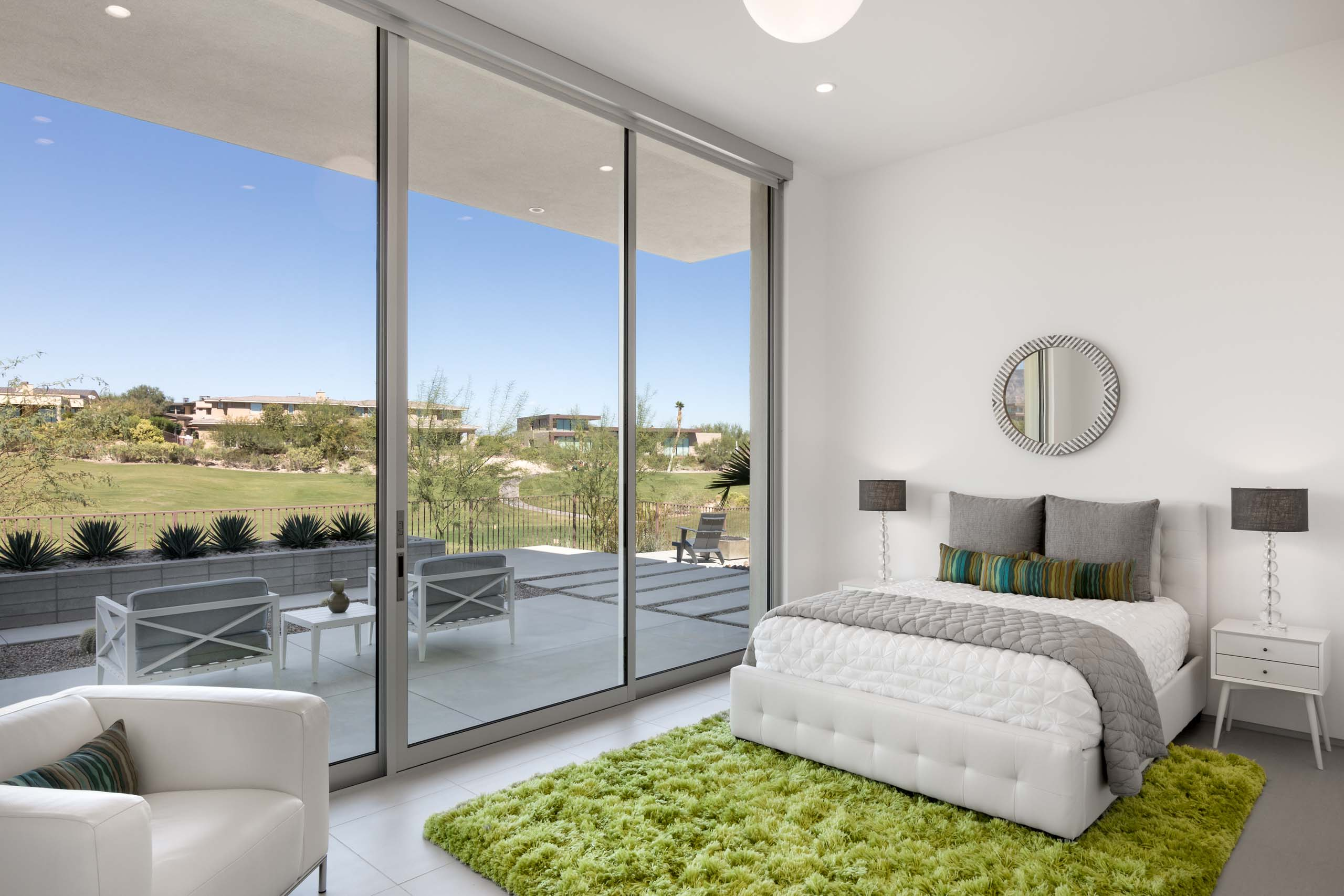 Each of the bedrooms features a Series 600 Multi-Slide Door.