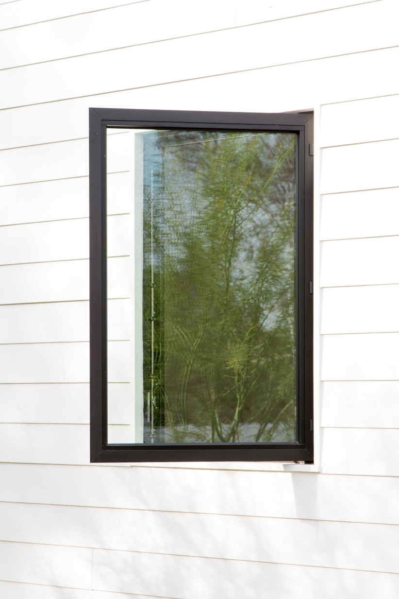 The clean aesthetic of Western Window Systems' hinged windows is on display.