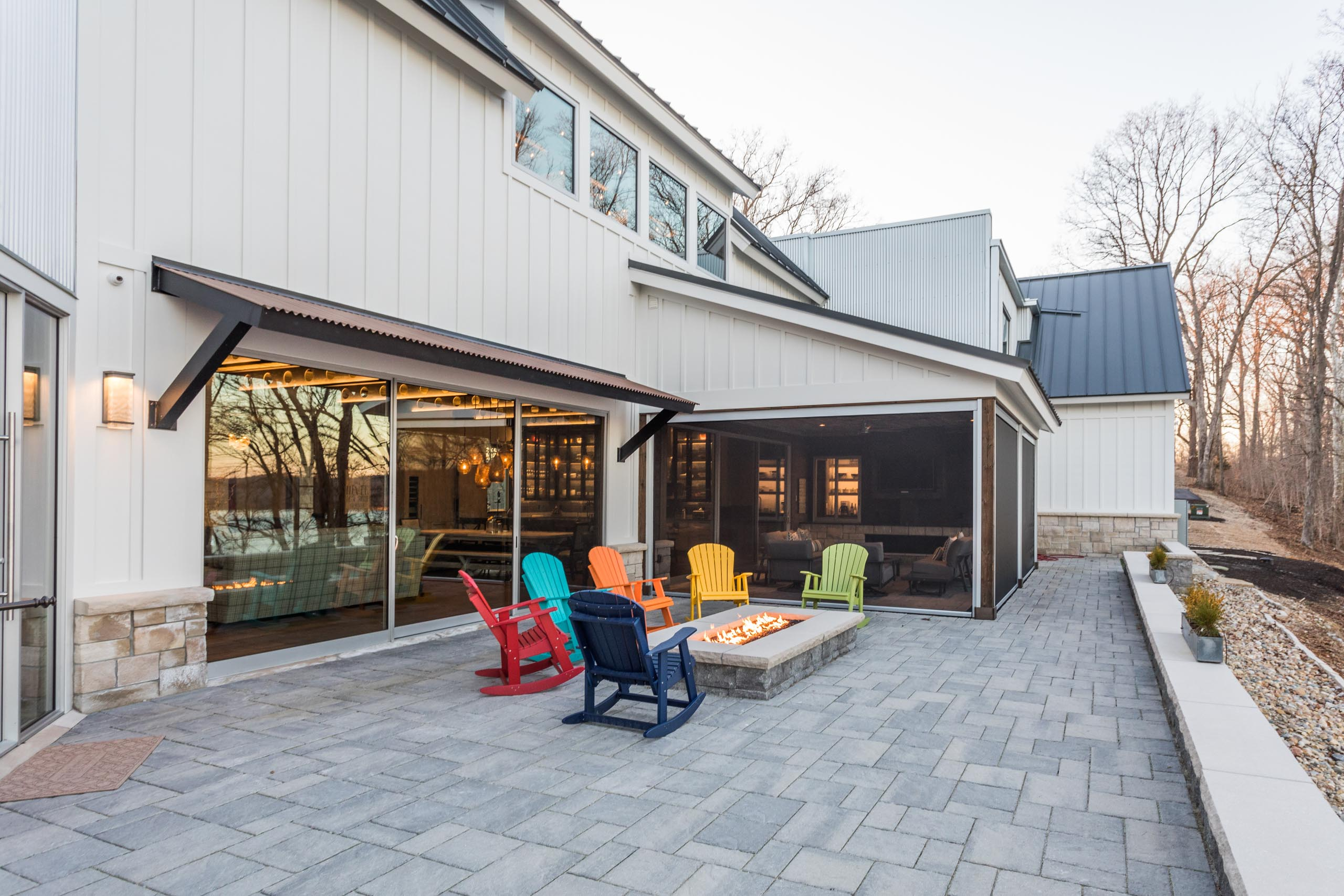 A multi-slide door seamlessly merges the great room to a fire-lit back patio.