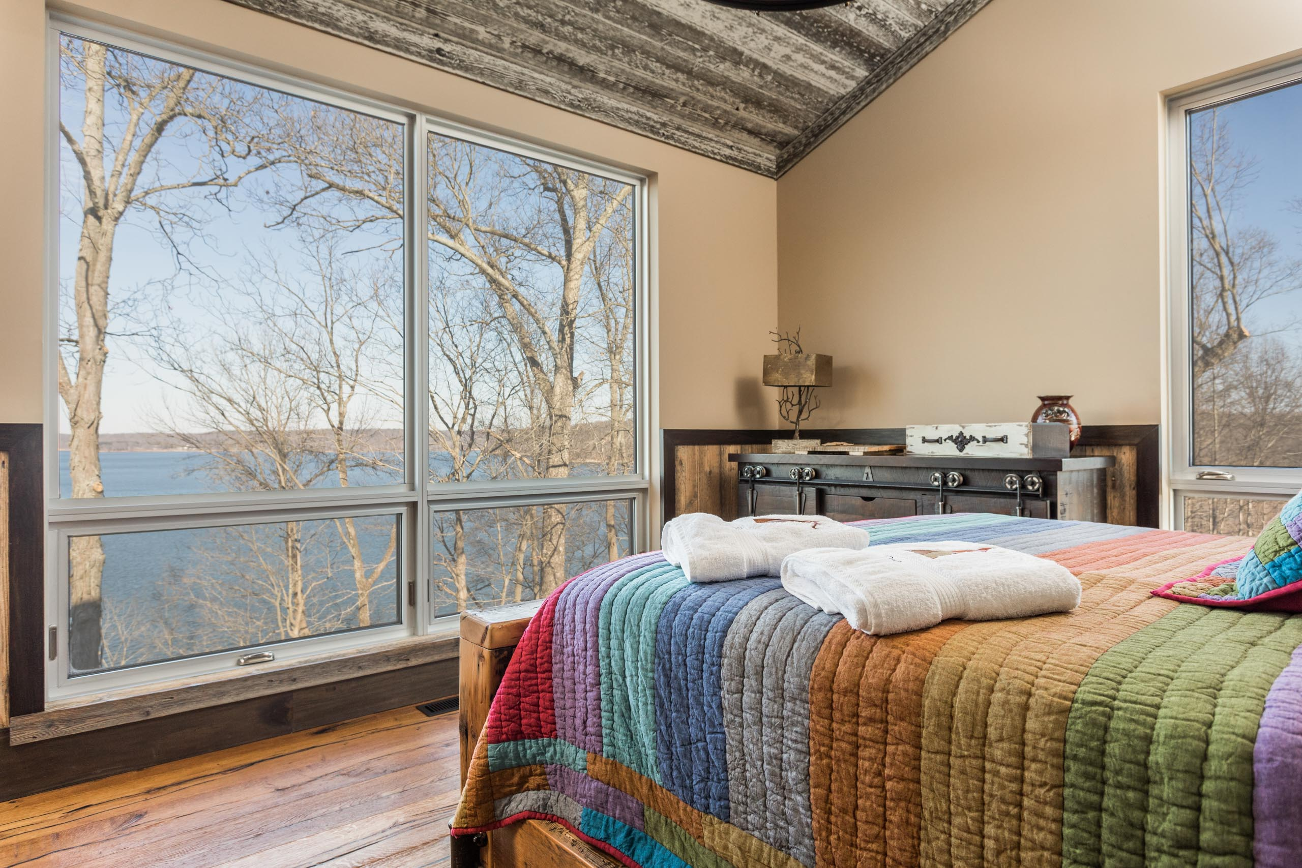 A combination of fixed and awning windows frame beautiful views of Lake Monroe.