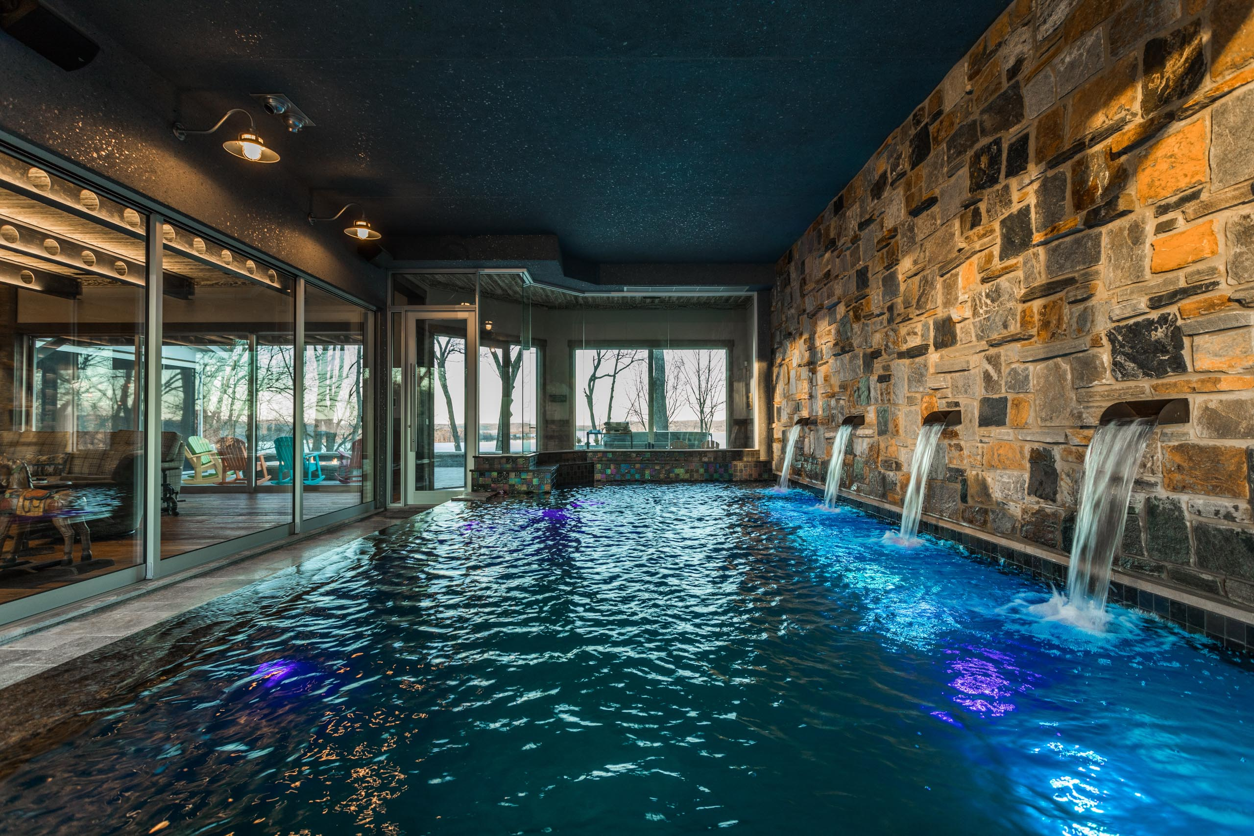 The indoor swimming pool is separated from the main living space from a huge multi-slide door.