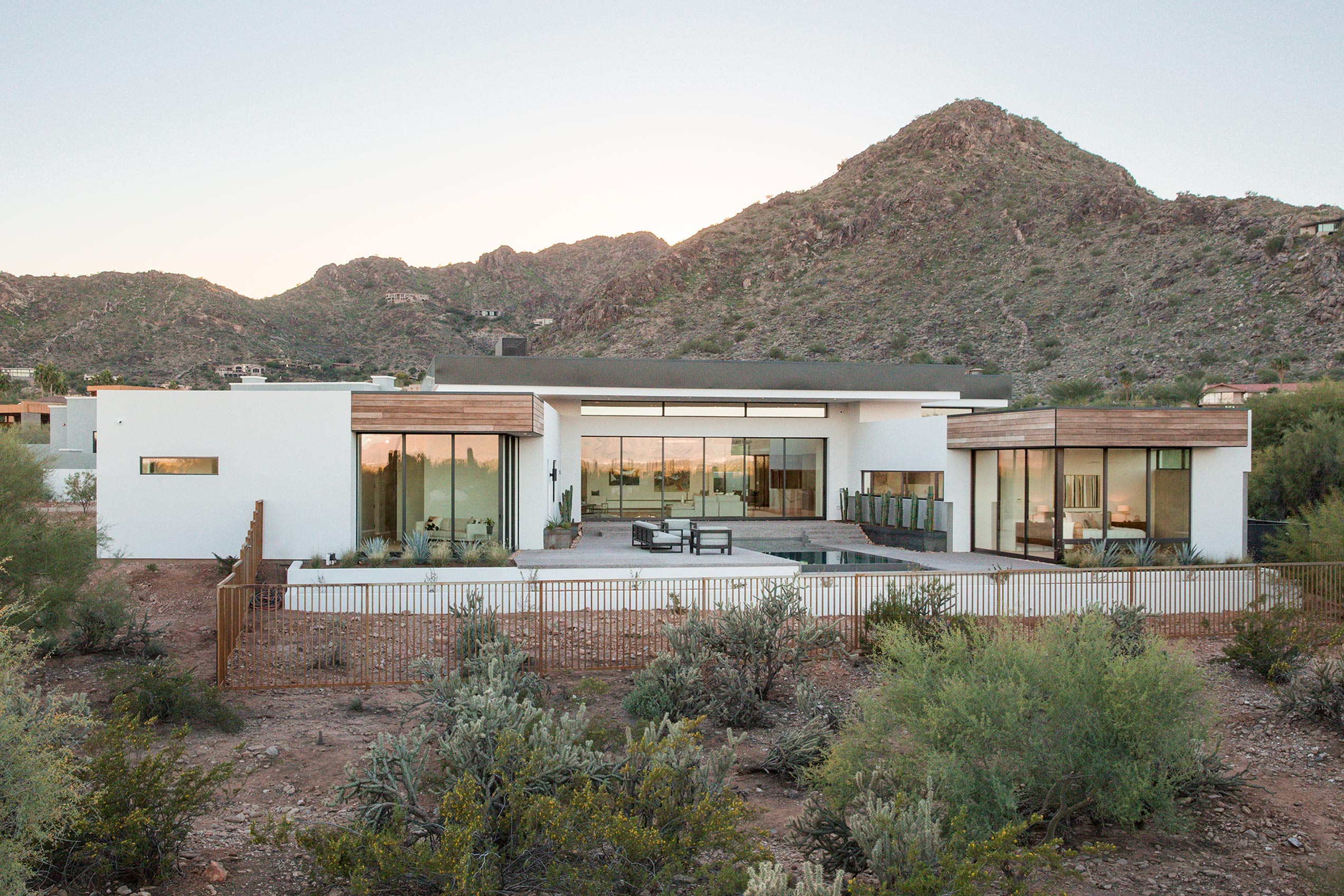 The 6,200-square-foot home's slight elevation maximizes the views through the massive windows.