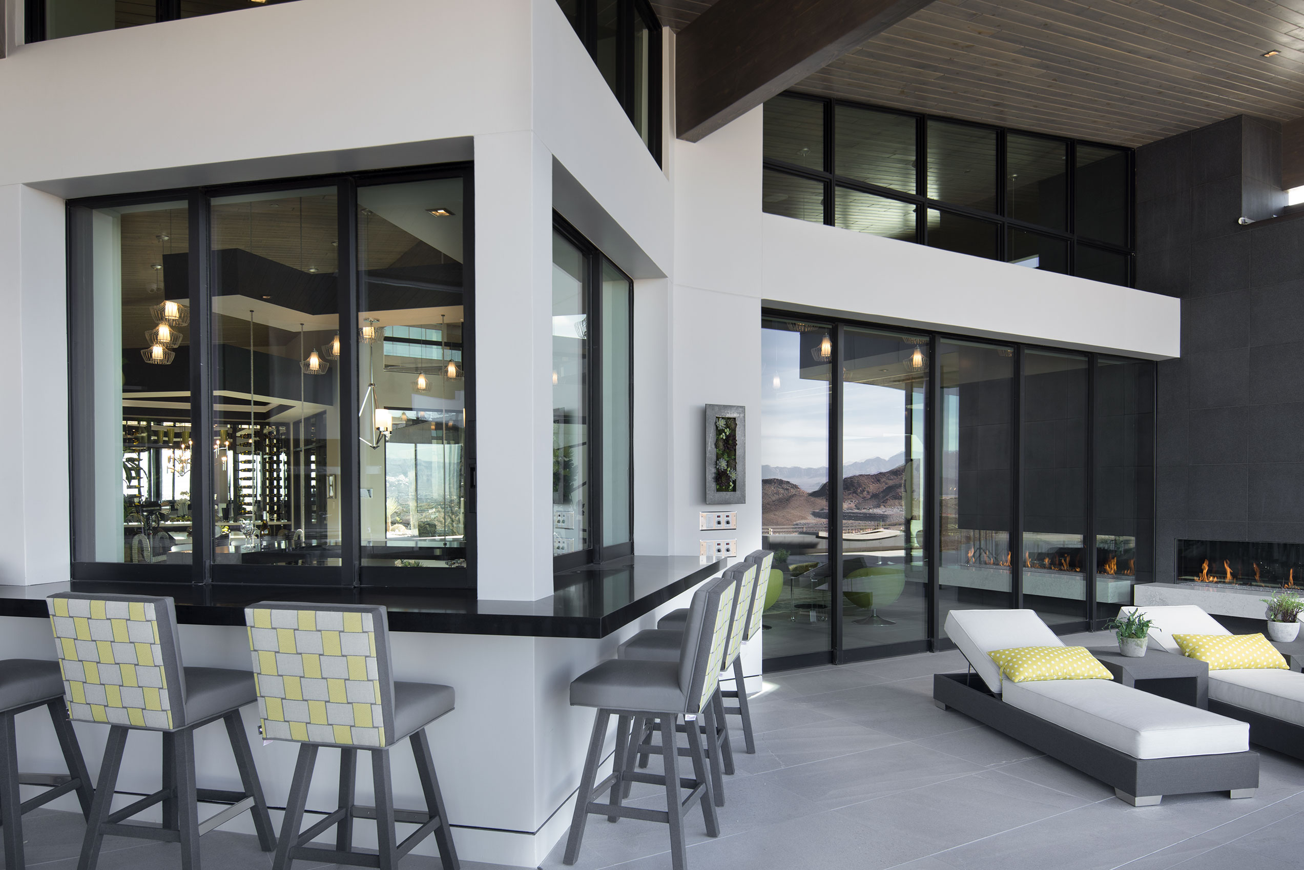 The back side of the home features an indoor-outdoor wet bar flanked on either side by huge Series 7600 Multi-Slide Doors.