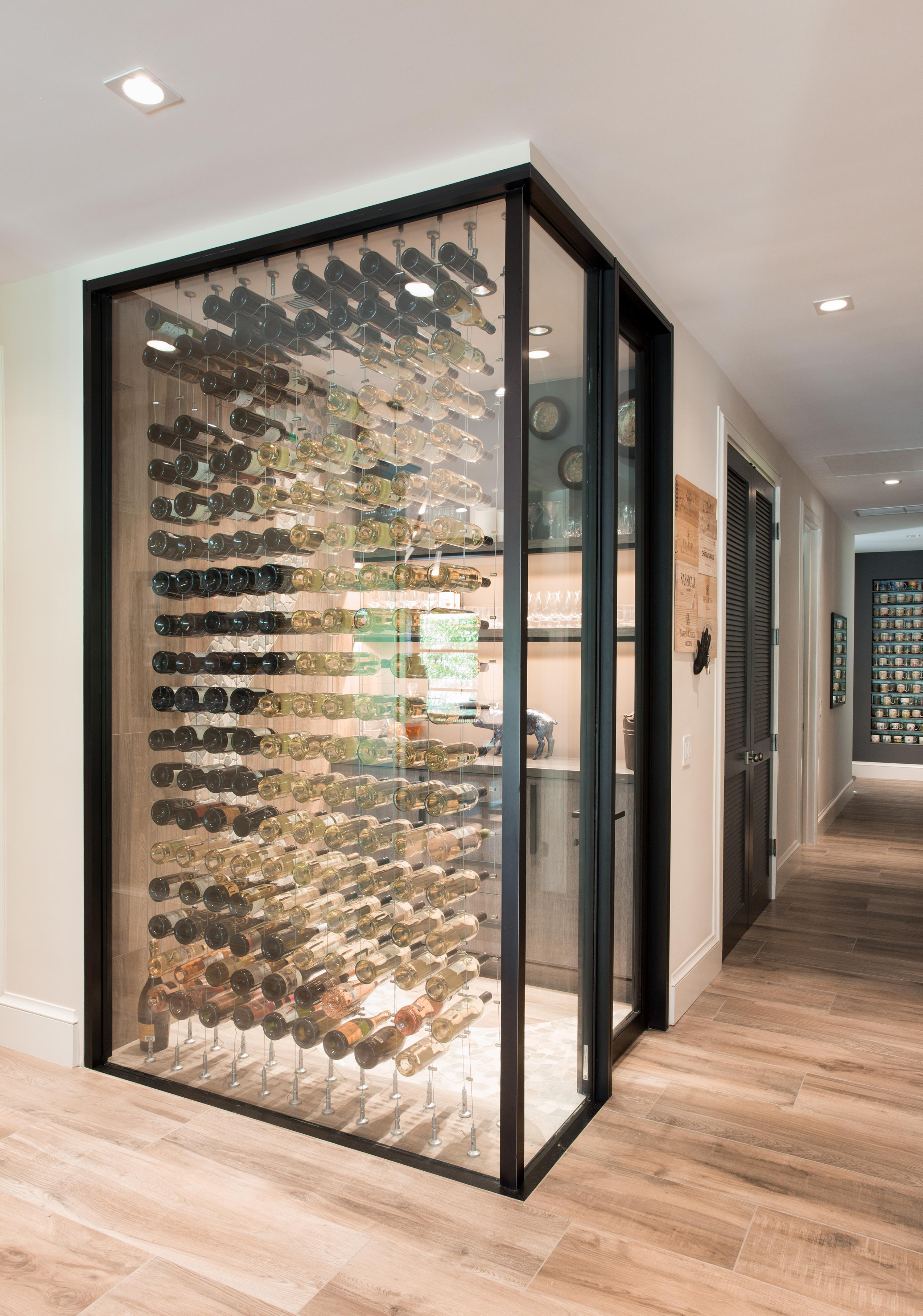 The glass-encased wine cellar is temperature-controlled at 57 degrees.