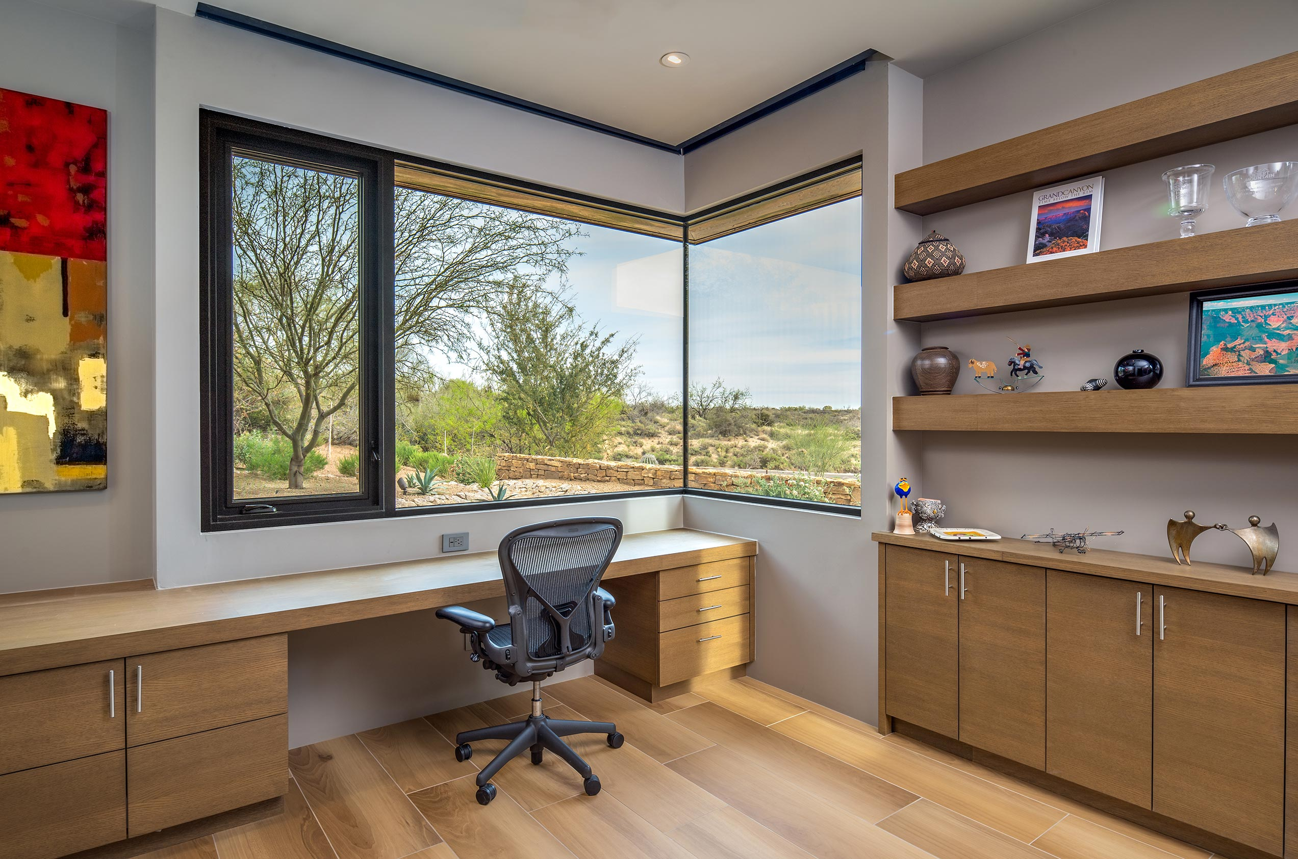 A Series 670 Casement Window in the home office swings open to let in fresh air.
