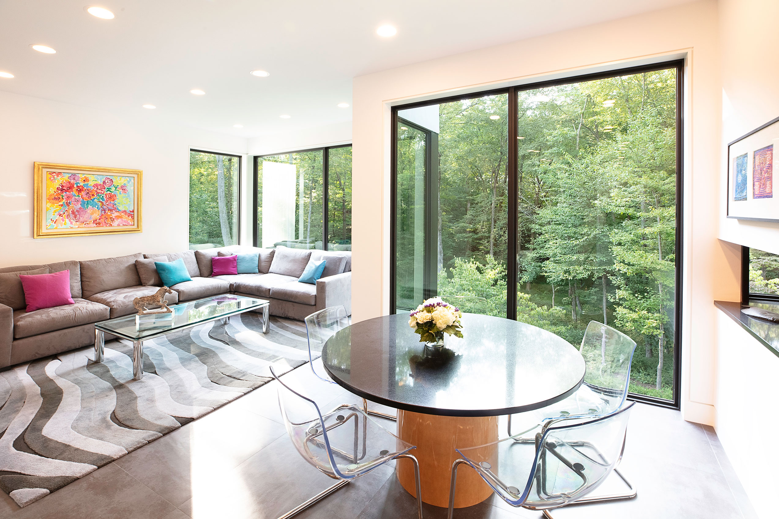 Glass frames the lush green landscape surrounding the Westchester County, New York home.