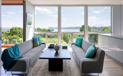 Windows let fresh air course throughout the living room.
