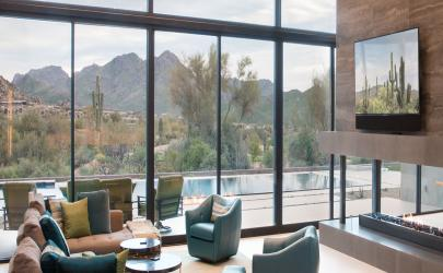 Overhangs and energy-efficient glass shield the home from the Arizona heat.